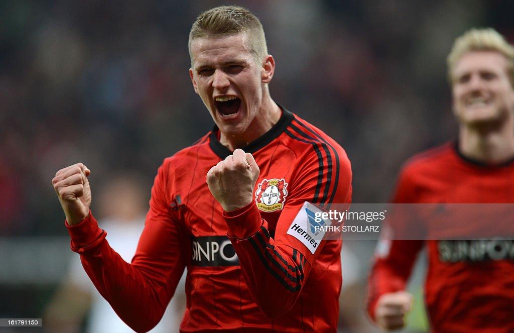 Leverkusen's midfielder Lars Bender celebrates after scoring the 2-0 during the German first division Bundesliga football match Bayer Leverkusen vs FC Augsburg in Leverkusen, western Germany, on February 16, 2013.