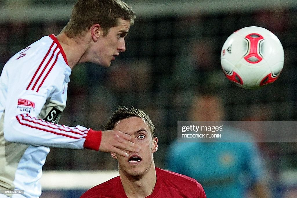 Leverkusen's midfielder Lars Bender (L) vies with Freiburg's midfielder Max Kruse during the German first division Bundesliga football match SC Freiburg vs Bayer 04 Leverkusen in Freiburg, southern Germany, on January 26, 2013. The match ended 0-0.