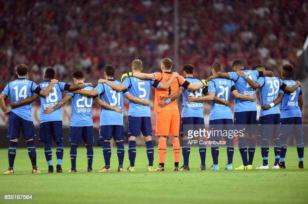 Leverkusen's players observe a minutes' silence for the victims of the attack in Barcelona prior to the German First division Bundesliga football...