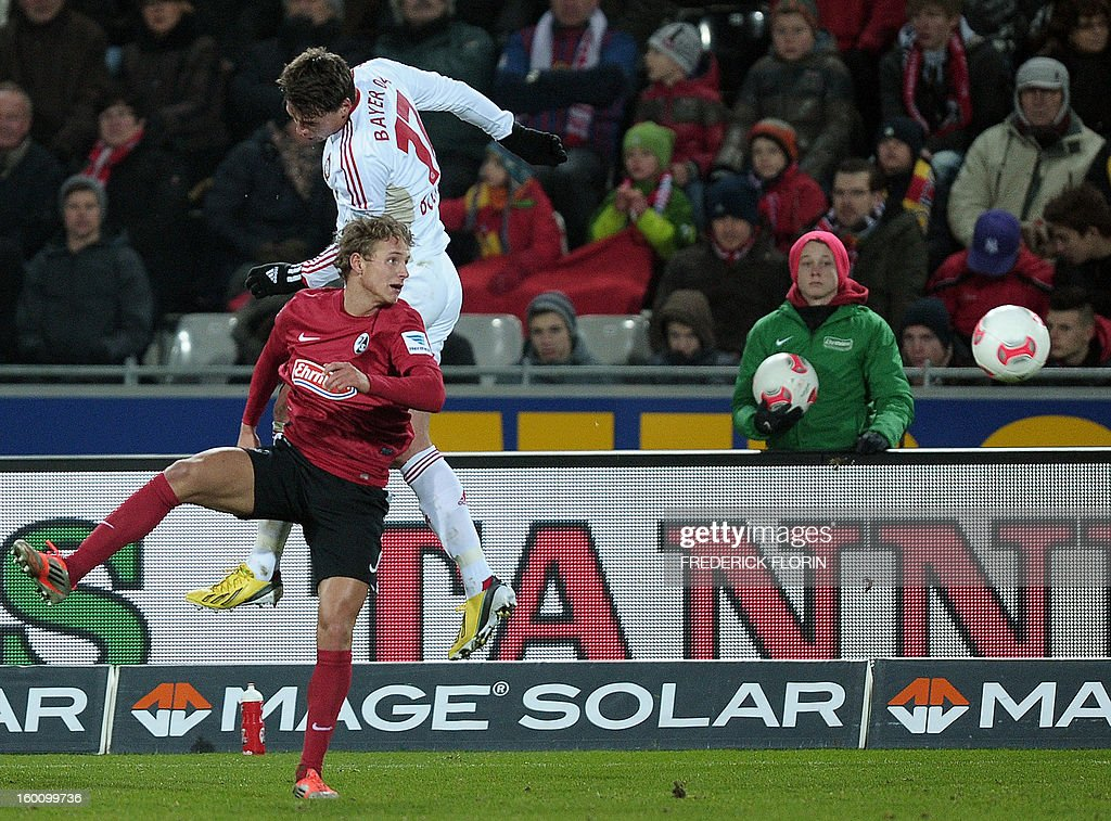 Leverkusen's Polish defender Sebastian Boenisch (top) vies with Freiburg's Norwegian defender Vegar Hedenstad during the German first division Bundesliga football match SC Freiburg vs Bayer 04 Leverkusen in Freiburg, southern Germany, on January 26, 2013. The match ended 0-0.