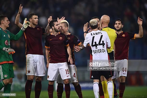 Leverkusen's Slovanian midfielder Kevin Kampl Leverkusen's goalkeeper Bernd Leno Roma's forward from BosniaHerzegovina Edin Dzeko Roma's midfielder...