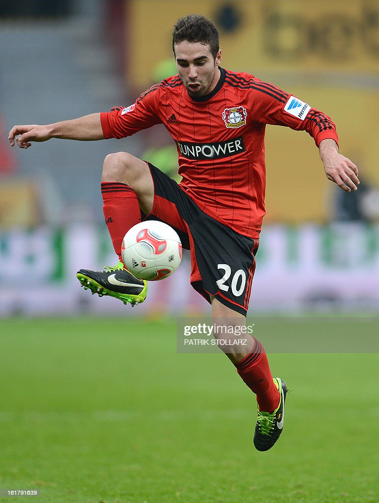 Leverkusen's Spanish defender Daniel Carvajal plays the ball during the German first division Bundesliga football match Bayer Leverkusen vs FC Augsburg in Leverkusen, western Germany, on February 16, 2013. Leverkusen won the match 2-1. AFP PHOTO / PATRIK STOLLARZ