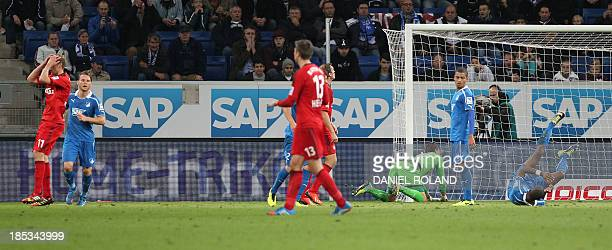 Leverkusen's Stefan Kiessling reacts after he thinks he missed a chance but the referee awarded the goal 20 despite angry protests during the German...