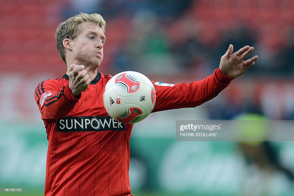 Leverkusen's striker Andre Schuerrle plays the ball during the German first division Bundesliga football match Bayer Leverkusen vs FC Augsburg in Leverkusen, western Germany, on February 16, 2013. Leverkusen won the match 2-1. AFP PHOTO / PATRIK STOLLARZ