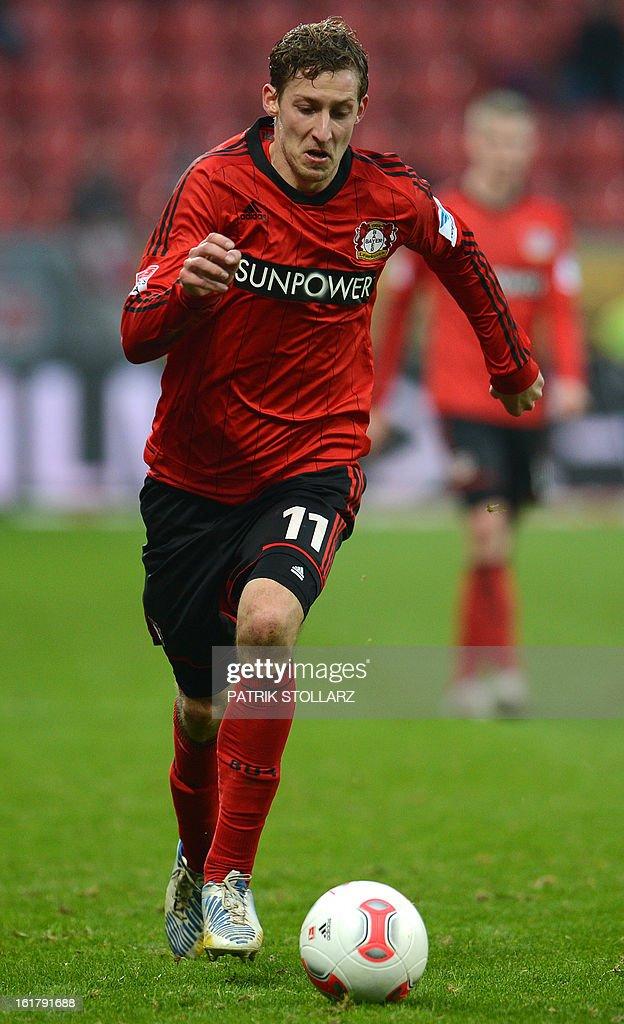 Leverkusen's striker Stefan Kiessling runs with the ball during the German first division Bundesliga football match Bayer Leverkusen vs FC Augsburg in Leverkusen, western Germany, on February 16, 2013. Leverkusen won the match 2-1.