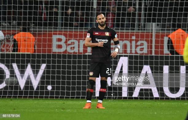 Leverkusen's Turkish defender Omer Toprak reacts after his penalty kick during the German First division Bundesliga football match Bayer Leverkusen...