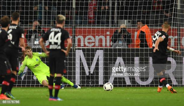 Leverkusen's Turkish defender Omer Toprak shoots a penalty during the German First division Bundesliga football match Bayer Leverkusen vs Werder...