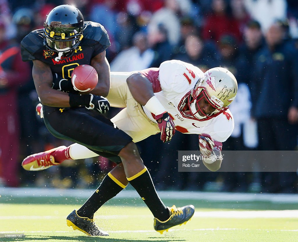 Levern Jacobs #8 of the Maryland Terrapins fumbles a kick off return after being hit by Chad Abram #41 of the Florida State Seminoles during the first half at Byrd Stadium on November 17, 2012 in College Park, Maryland.