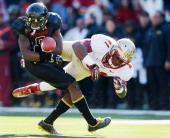 Levern Jacobs of the Maryland Terrapins fumbles a kick off return after being hit by Chad Abram of the Florida State Seminoles during the first half...