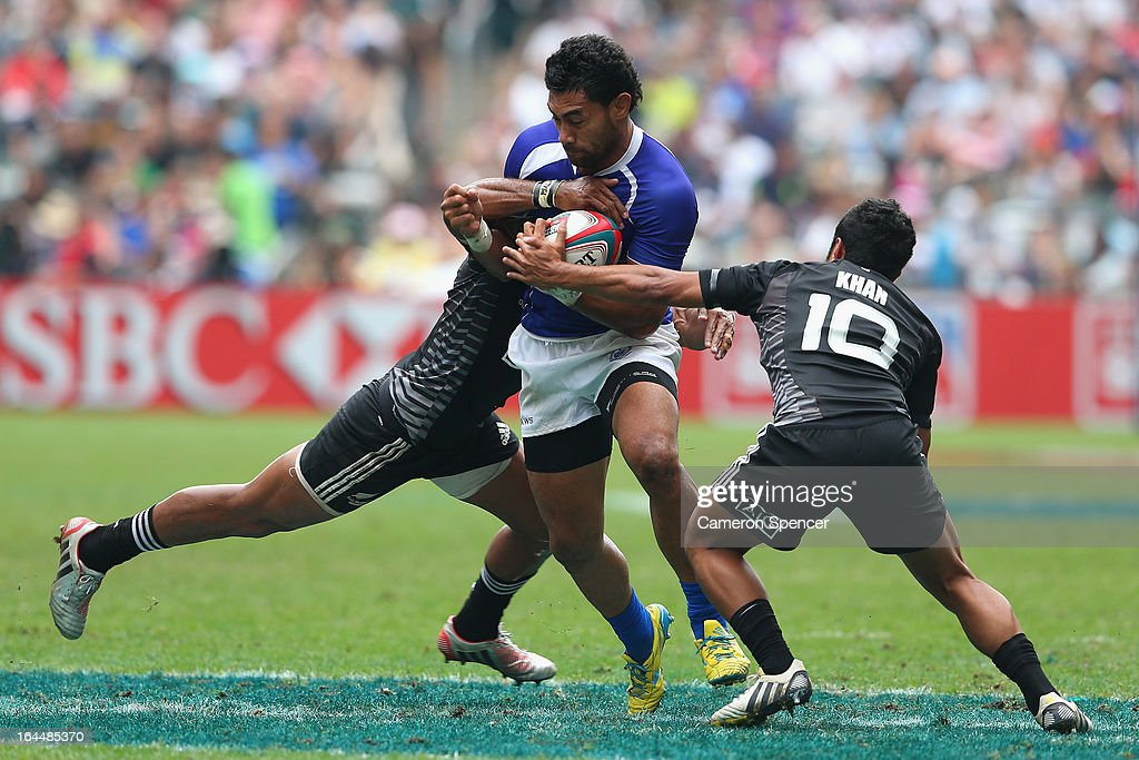 Levi Asifa'amatala of Samoa is tackled during the Cup Quarter Final match between New Zealand and Samoa during day three of the 2013 Hong Kong Sevens at Hong Kong Stadium on March 24, 2013 in So Kon Po, Hong Kong.