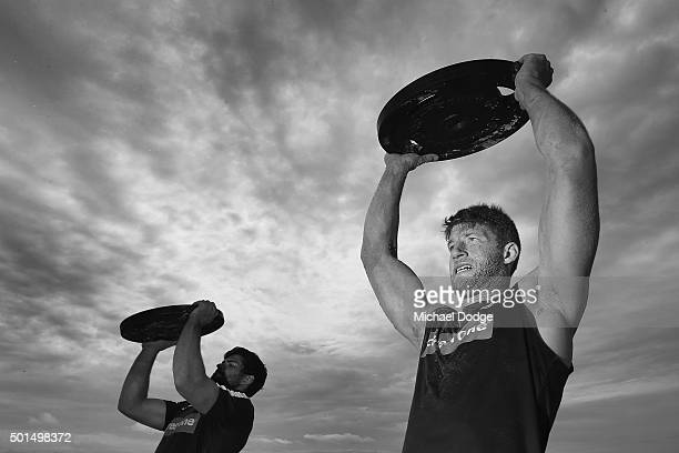 Levi Casboult and Sam Rowe lift weights during a circuit training session at Kurrawa Beach during the Carlton Blues AFL preseason training camp on...