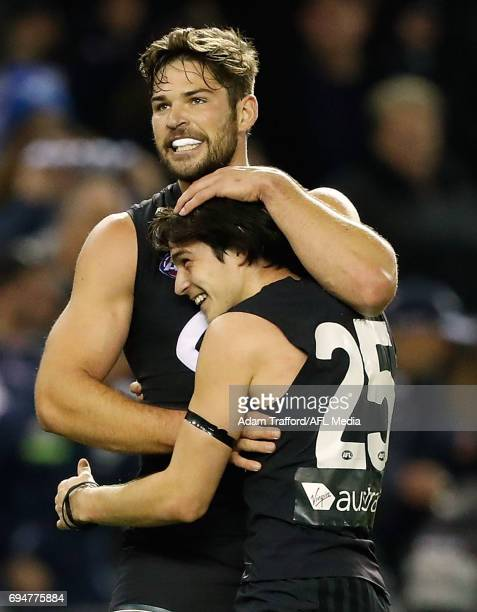 Levi Casboult and Zac Fisher of the Blues celebrate on the final siren during the 2017 AFL round 12 match between the Carlton Blues and the GWS...