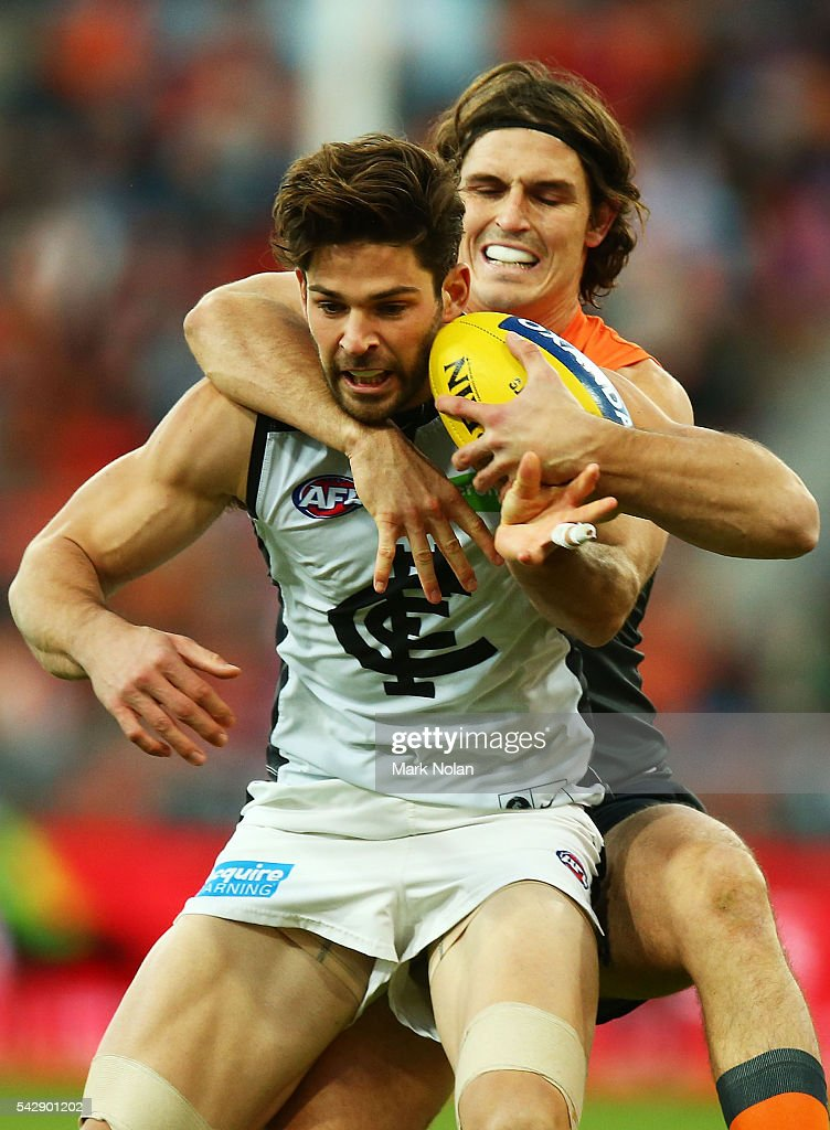 Levi Casboult of Carlton and <a gi-track='captionPersonalityLinkClicked' href=/galleries/search?phrase=Phil+Davis+-+Australian+Rules+Football+Player&family=editorial&specificpeople=12779790 ng-click='$event.stopPropagation()'>Phil Davis</a> of the Giants contest possession during the round 14 AFL match between the Greater Western Sydney Giants and the Carlton Blues at Spotless Stadium on June 25, 2016 in Sydney, Australia.