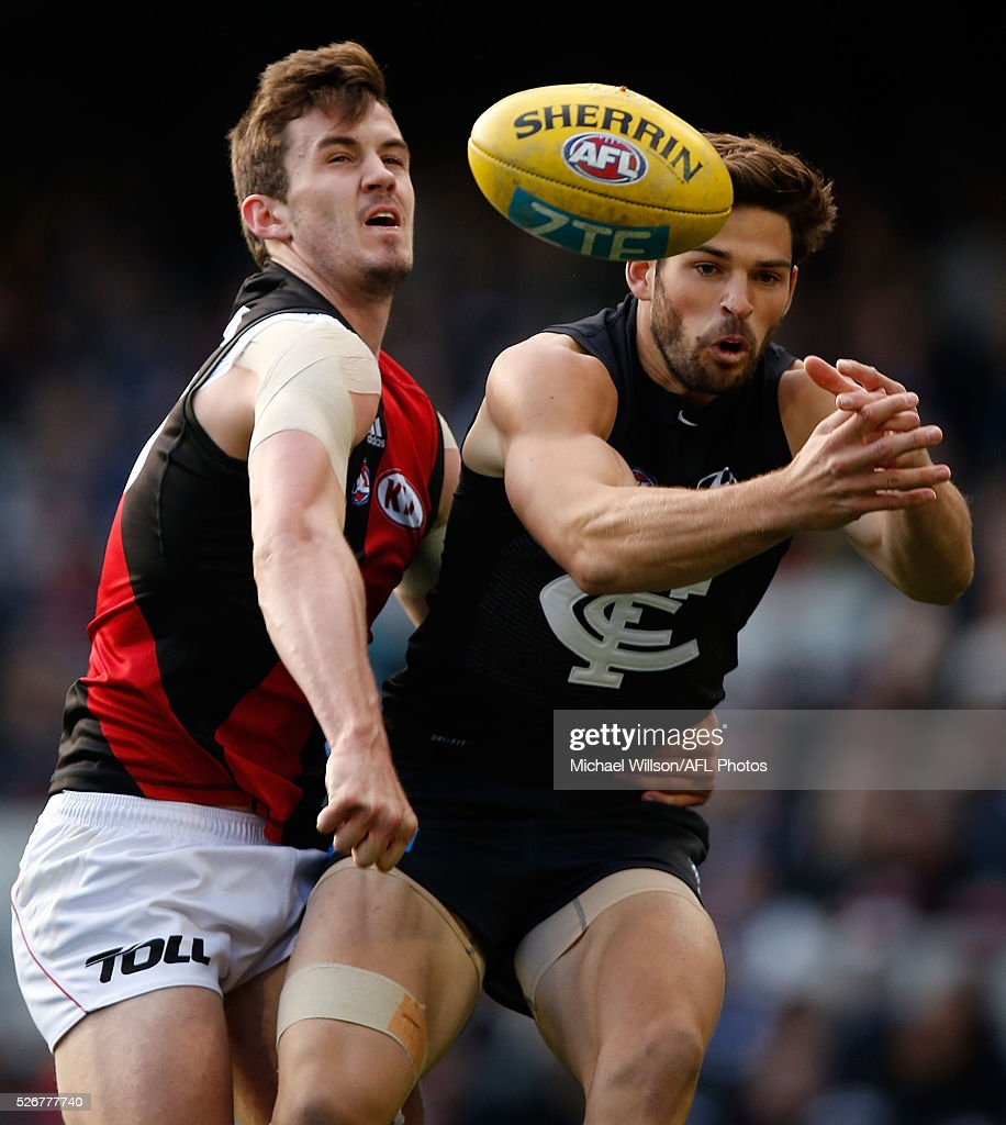 Levi Casboult of the Blues and Michael Hartley of the Bombers compete for the ball during the 2016 AFL Round 06 match between the Carlton Blues and the Essendon Bombers at the Melbourne Cricket Ground, Melbourne on May 1, 2016.