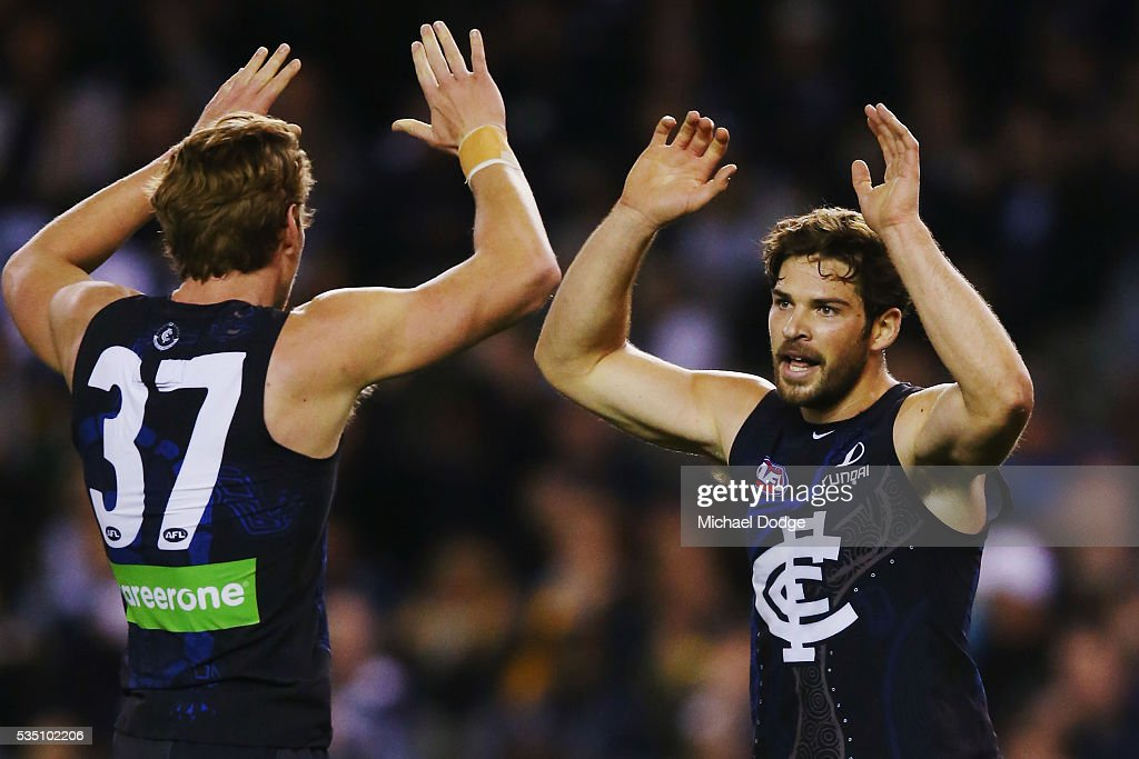Levi Casboult of the Blues celebrates a goal with Daniel Gorringe during the round 10 AFL match between the Carlton Blues and the Geelong Cats at Etihad Stadium on May 29, 2016 in Melbourne, Australia.