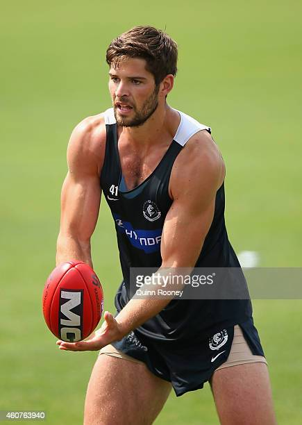 Levi Casboult of the Blues handballs during a Carlton Blues AFL Training session at Visy Park on December 22 2014 in Melbourne Australia