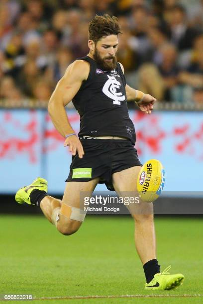 Levi Casboult of the Blues kicks the ball during the round one AFL match between the Carlton Blues and the Richmond Tigers at Melbourne Cricket...