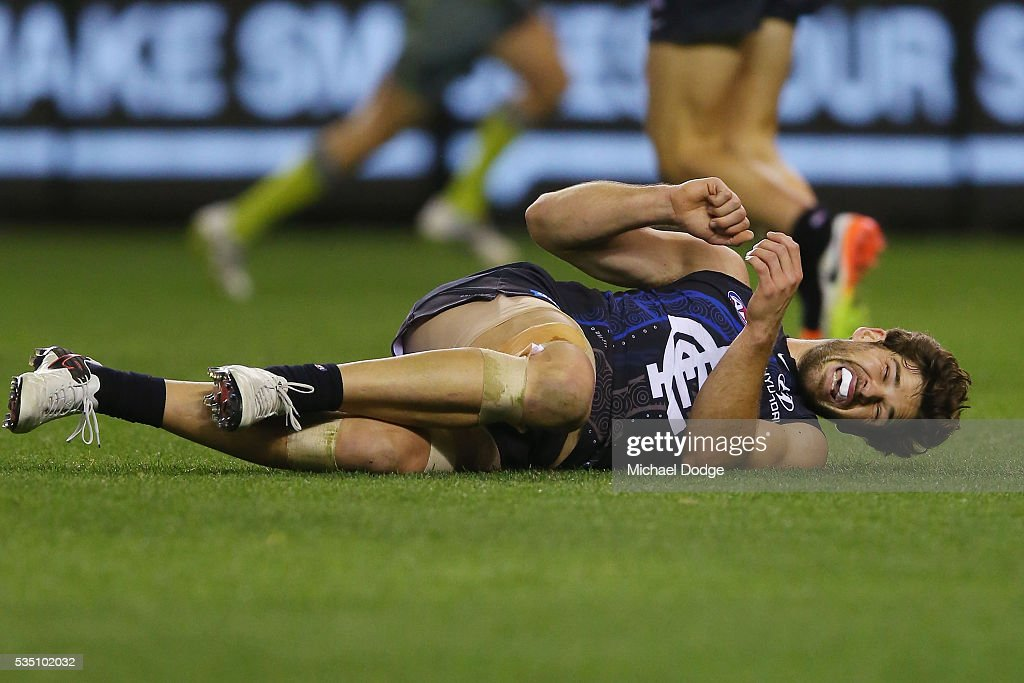 Levi Casboult of the Blues reacts after winding himself from a contest during the round 10 AFL match between the Carlton Blues and the Geelong Cats at Etihad Stadium on May 29, 2016 in Melbourne, Australia.