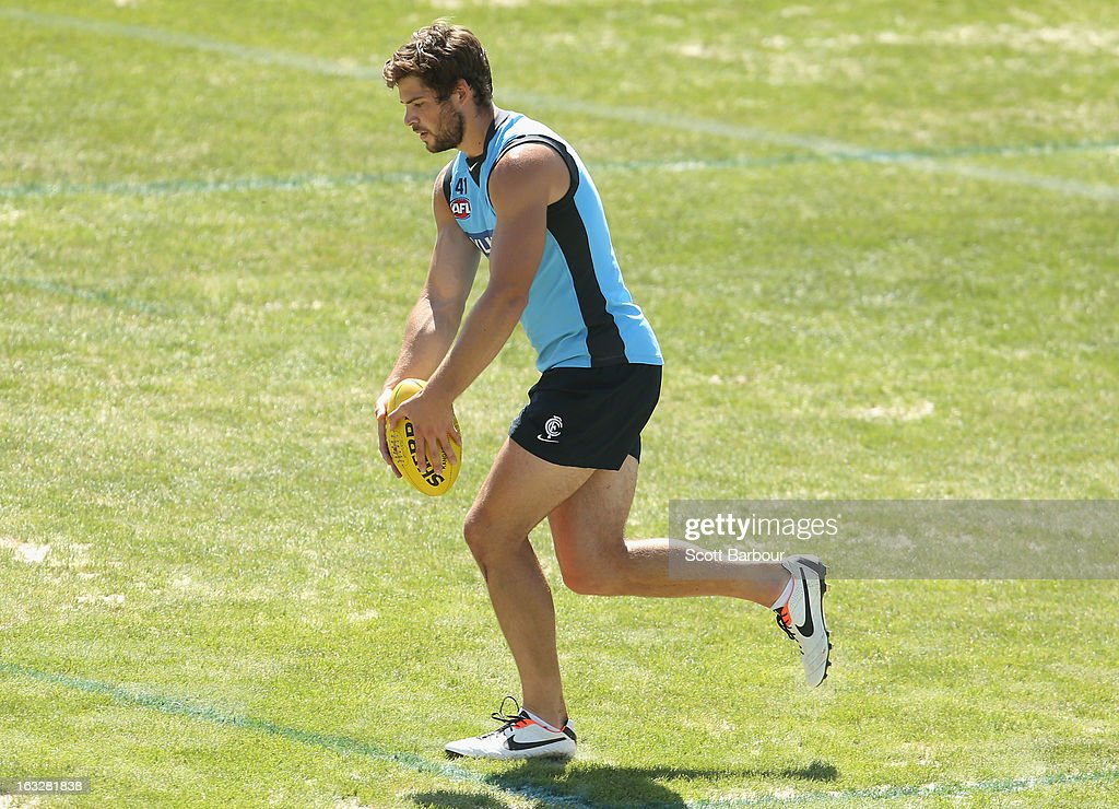 Levi Casboult of the Blues runs with the ball during a Carlton Blues AFL training session at Visy Park on March 7, 2013 in Melbourne, Australia.