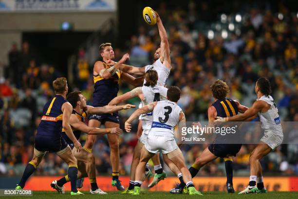 Levi Casboult of the Blues wins a ruck contest against Nathan Vardy of the Eagles during the round 21 AFL match between the West Coast Eagles and the...