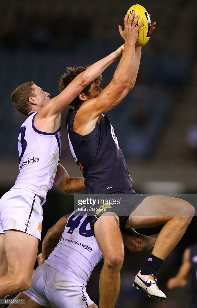 Levi Casboult of the Carlton Blues marks the ball against Zac Dawson of the Fremantle Dockers during the round two AFL NAB Cup match between the Carlton Blues and the Fremantle Dockers at Etihad Stadium on March 2, 2013 in Melbourne, Australia.