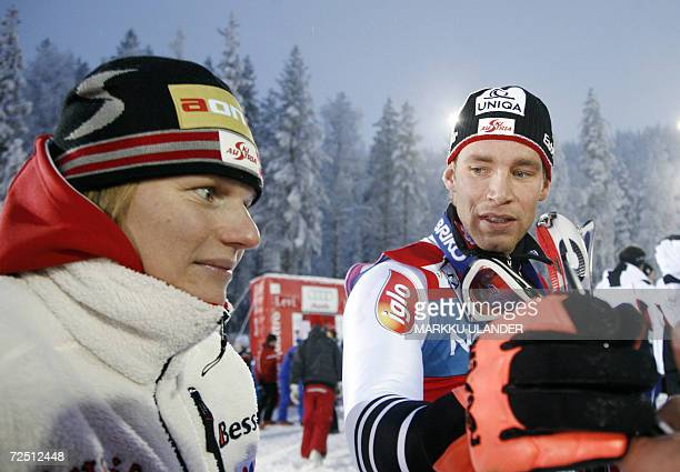 Austria's Marlies Schild who won the women's slalom yesterday chats with Benjamin Raich of Austria after he won the men's season opening FIS World...