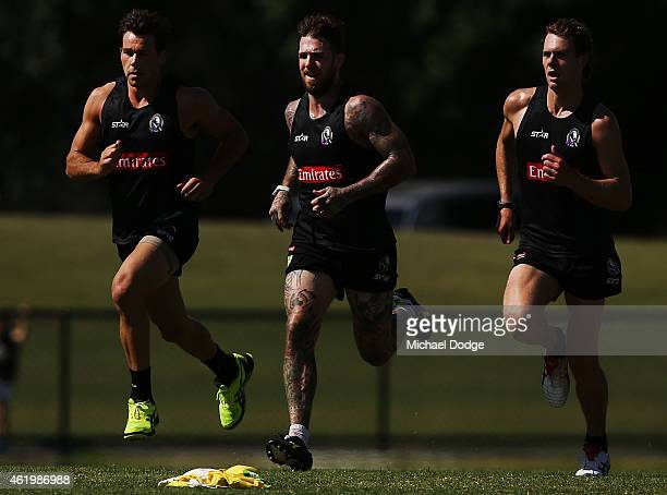 Levi Greenwood Dane Swan and Matt Scharenberg run hard during a Collingwood Magpies AFL training session at Olympic Park on January 23 2015 in...