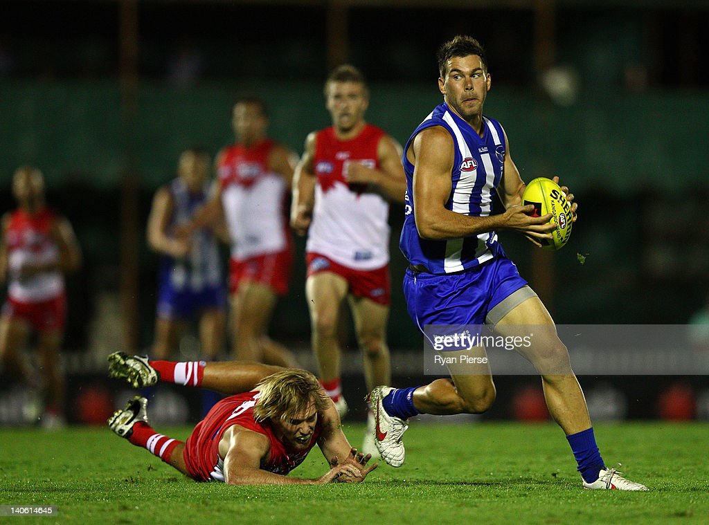 Levi Greenwood of the Kangaroos breaks the tackle of Lewis Roberts-Thompson of the Swans during the round two NAB Cup AFL match between the Sydney Swans and the North Melbourne Kangaroos at Bruce Purser Oval on March 3, 2012 in Sydney, Australia.