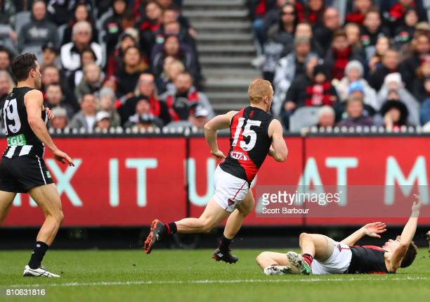 Levi Greenwood of the Magpies after a high hit on Zach Merrett of the Bombers during the round 16 AFL match between the Collingwood Magpies and the...