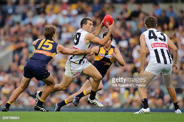 Levi Greenwood of the Magpies controls the ball during the round six AFL match between the West Coast Eagles and the Collingwood Magpies at Domain...