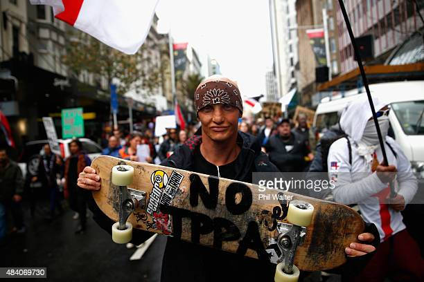 Levi Hawken joins an anti TPPA protest march down Queen Street on August 15 2015 in Auckland New Zealand The TransPacific Partnership Agreement is a...
