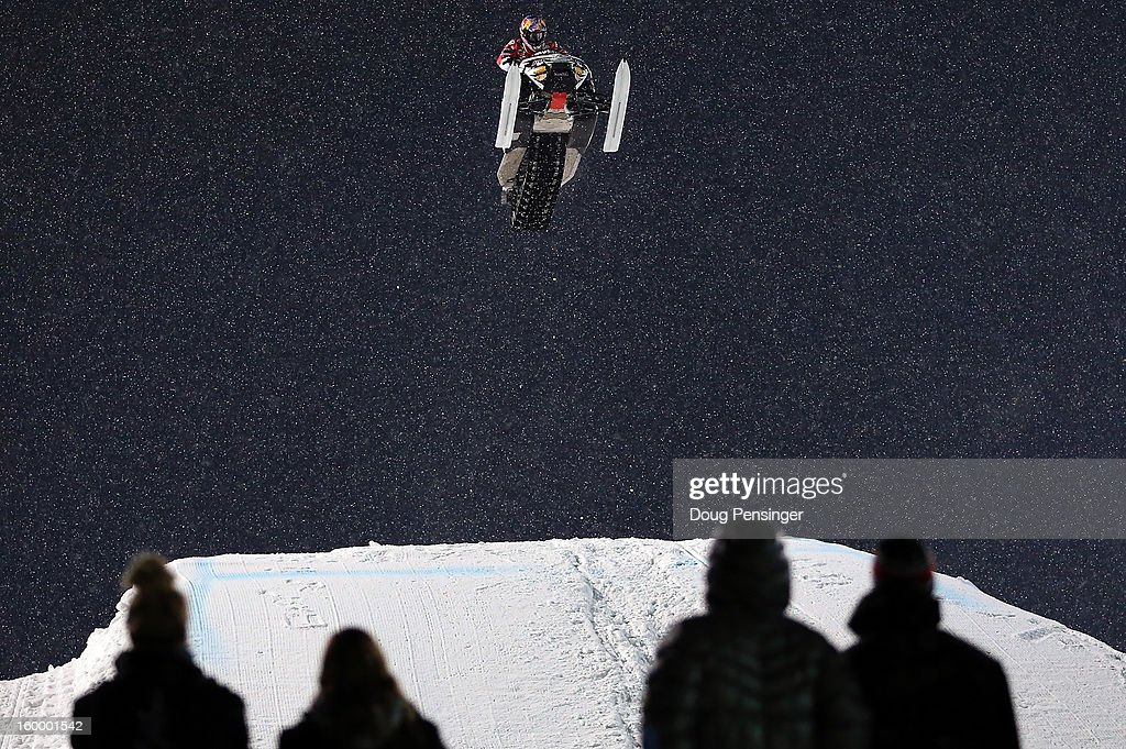Levi LaVallee goes airborne en route to winning the golf medal in the Snowmobile Freestyle at Winter X Games Aspen 2013 at Buttermilk Mountain on January 24, 2013 in Aspen, Colorado.