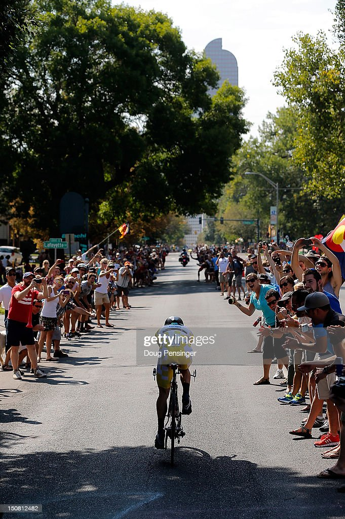 Levi Leipheimer of the USA riding for Omega Pharma-Quickstep is cheered on by fans as he races to ninth place in the individual time trial during stage seven and finished in third place in the 2012 USA Pro Challenge on August 26, 2012 in Denver, Colorado.