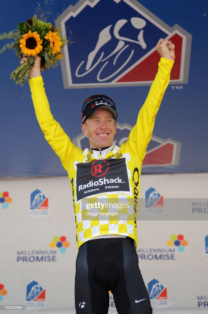 <a gi-track='captionPersonalityLinkClicked' href=/galleries/search?phrase=Levi+Leipheimer&family=editorial&specificpeople=236122 ng-click='$event.stopPropagation()'>Levi Leipheimer</a> of the USA riding for Team Radioshack takes the podium following stage six as he defended the overall leader's jersey and won the general classification of the 2011 USA Pro Cycling Challenge on August 28, 2011 in Denver, Colorado.