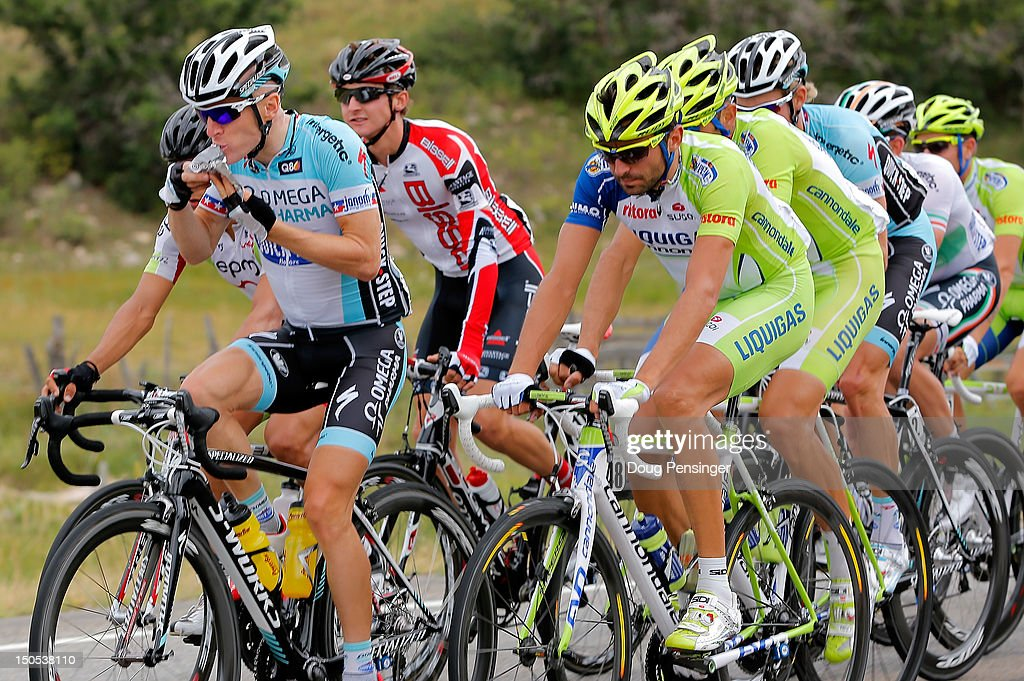 <a gi-track='captionPersonalityLinkClicked' href=/galleries/search?phrase=Levi+Leipheimer&family=editorial&specificpeople=236122 ng-click='$event.stopPropagation()'>Levi Leipheimer</a> riding for Omega Pharma-Quickstep has a snack as he rides in the peloton during stage one of the USA Pro Challenge from Durango to Telluride on August 20, 2012 in Durango, Colorado.