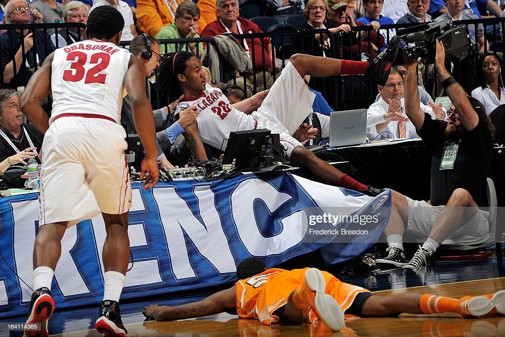 Levi Randolph #20 of the Alabama Crimson Tide crashes into the media table during a game against the University of Tennessee Volunteers during the Quarterfinals of the SEC Tournament at the Bridgestone Arena on March 15, 2013 in Nashville, Tennessee.