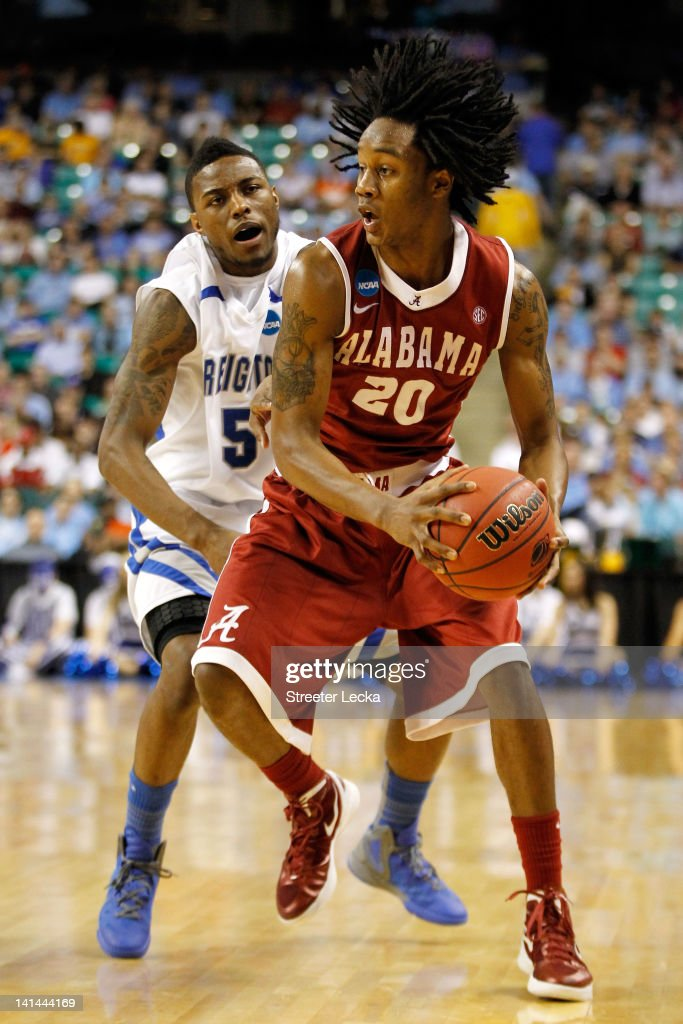 Levi Randolph of the Alabama Crimson Tide handles the ball against Josh Jones of the Creighton Bluejays during the second round of the 2012 NCAA...