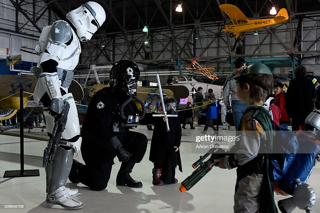 Levi Rosser, dressed as Kilo Ren, poses for a photo with a Stormtrooper and Tie Fighter Pilot during a Star Wars themed day at Wings Over the Rockies on Sunday, May 1, 2016.