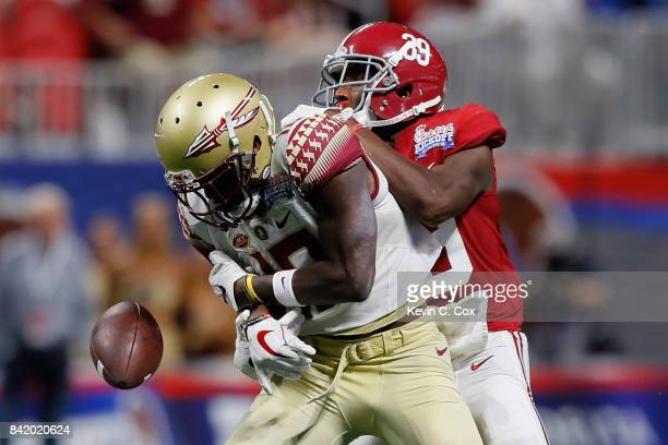 Levi Wallace of the Alabama Crimson Tide breaks up a pass intended for Auden Tate of the Florida State Seminoles during their game at MercedesBenz...