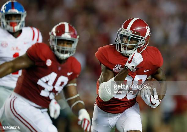 Levi Wallace of the Alabama Crimson Tide returns this interception for a touchdown against the Mississippi Rebels at BryantDenny Stadium on September...