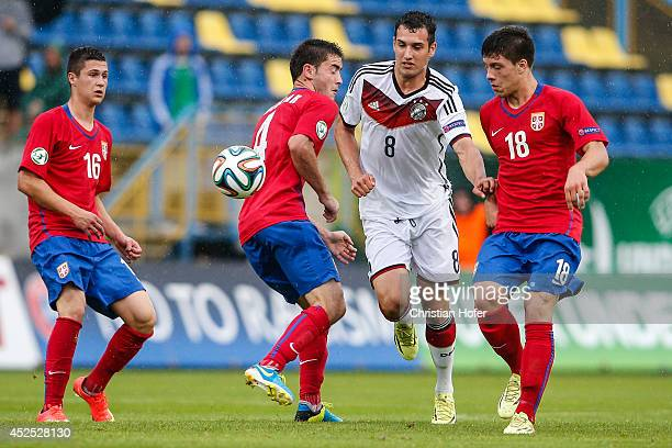 Levin Mete Oeztunali of Germany challenges Danilo Pantic Sasa Zdjelar and Luka Jovic of Serbia during the UEFA Under19 European Championship match...