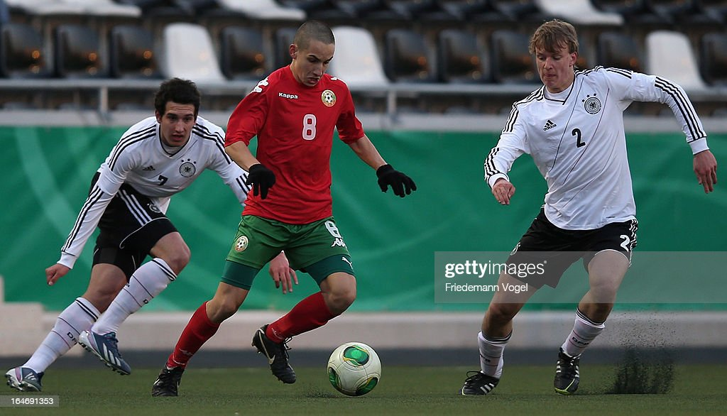 Levin Mete Oezuntali (L), Lukas Klostermann (R) of Germany and Emil Svetoslavov (C) of Bulgaria battle for the ball during the UEFA Under17 Elite Round match between Germany and Bulgaria at Toennies-Arena on March 26, 2013 in Rheda-Wiedenbruck, Germany.