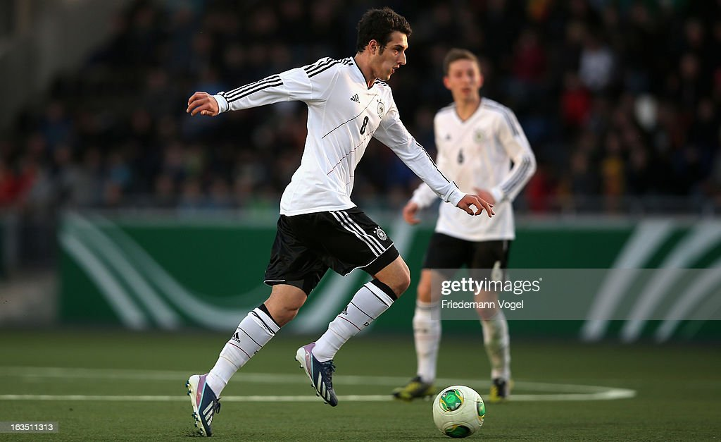 Levin Oetzunali of Germany runs with the ball during the U17 International Friendly match between Germany and Georgia at Toennies-Arena on March 6, 2013 in Rheda-Wiedenbruck, Germany.