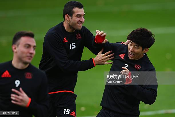 Levin Oeztunali and HeungMin Son attends a Bayer Leverkusen training session ahead of their UEFA Champions League Group C match against Zenit...