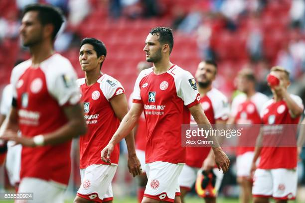 Levin Oeztunali and team mates of Mainz react after the Bundesliga match between 1 FSV Mainz 05 and Hannover 96 at Opel Arena on August 19 2017 in...