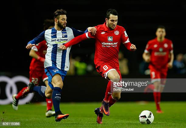 Levin Oeztunali of 1 FSV Mainz 05 is challenged by Marvin Plattenhardt of Hertha BSC during the Bundesliga match between Hertha BSC and 1 FSV Mainz...