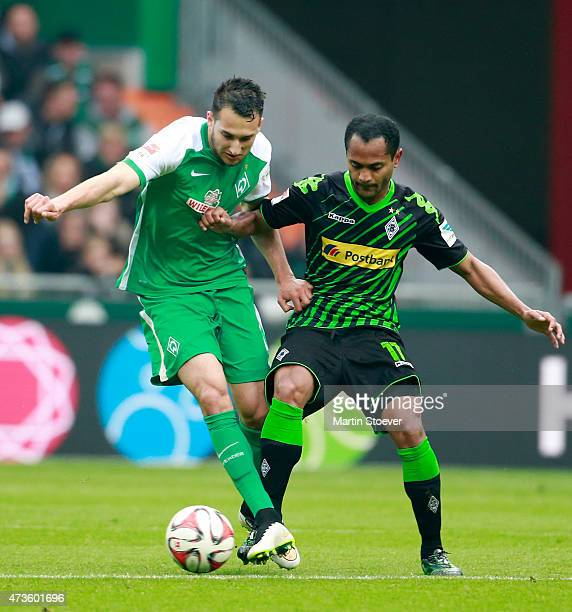 Levin Oeztunali of Bremen and Raffael of Moenchengladbach battle for the ball during the Bundesliga match between SV Werder Bremen and Borussia...