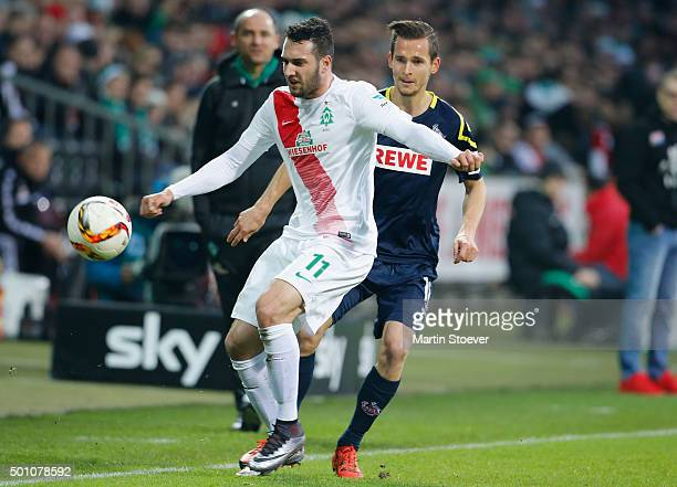 Levin Oeztunali of Bremen challenges Pavel Olkowski of Koeln during the Bundesliga match between Werder Bremen and 1 FC Koeln at Weserstadion on...