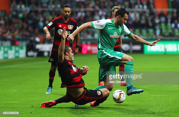Levin Oeztunali of Bremen is challenged by Giulio Donati of Leverkusen during the Bundesliga match between Werder Bremen and Bayer Leverkusen at...