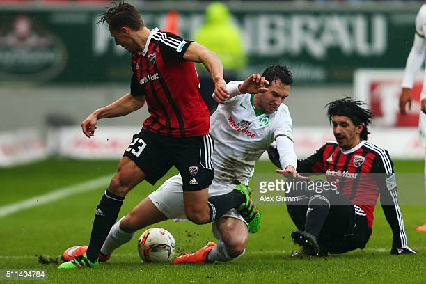 Levin Oeztunali of Bremen is challenged by Robert Bauer and Almog Cohen of Ingolstadt during the Bundesliga match between FC Ingolstadt and Werder...